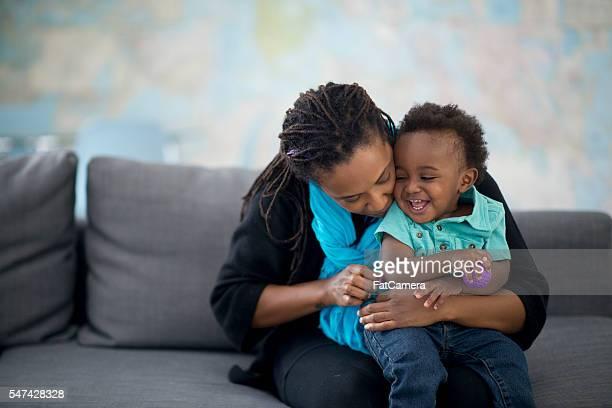 Mother Hugging Her Little Boy