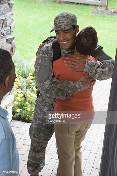 Mother Hugging Returning Soldier