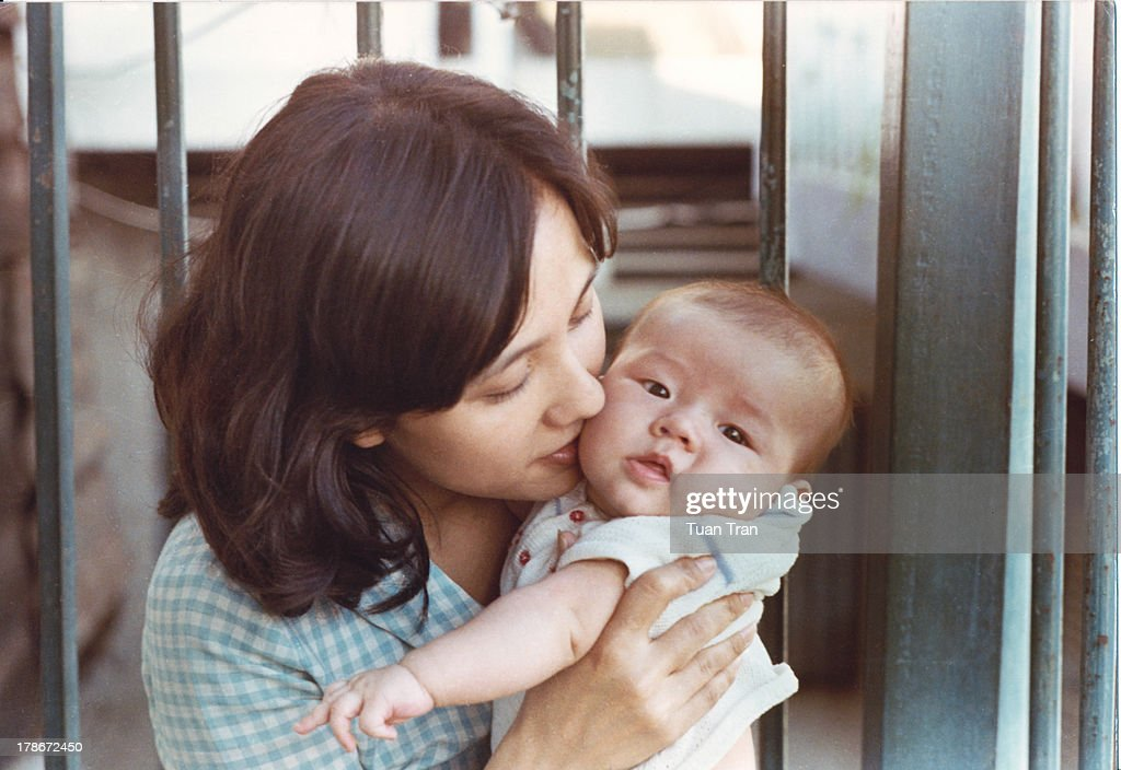 Mother hugging son : Stock Photo