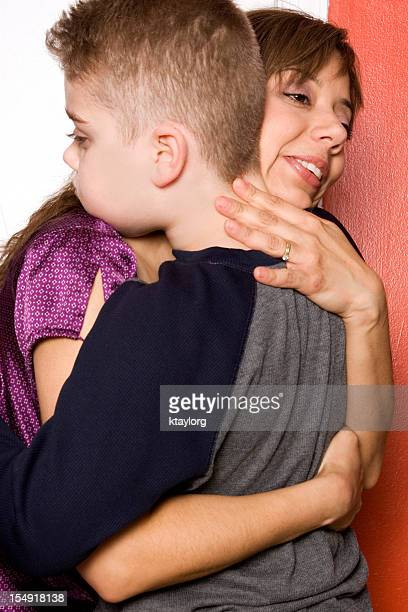Mother hugs her autistic son
