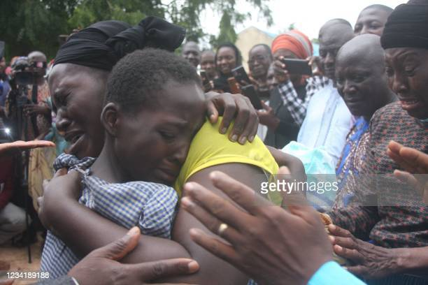 Mother hugs her daughter on July 25, 2021 after she was released together with other 27 students of the Bethel Baptist High School. - Gunmen who...