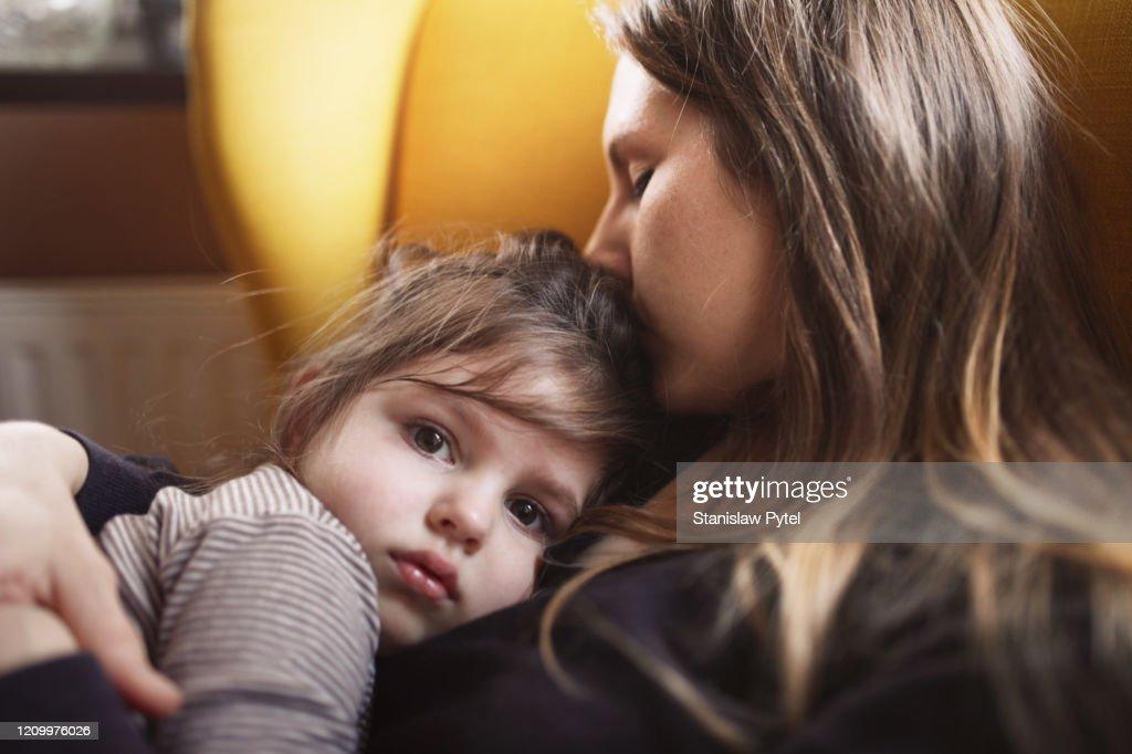 Mother hugs sad daughter : Stock Photo