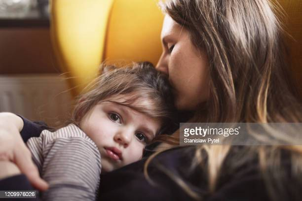 mother hugs sad daughter - family with one child stock pictures, royalty-free photos & images