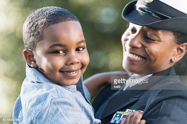 mother in navy officer uniform holding son - navy stock pictures, royalty-free photos & images