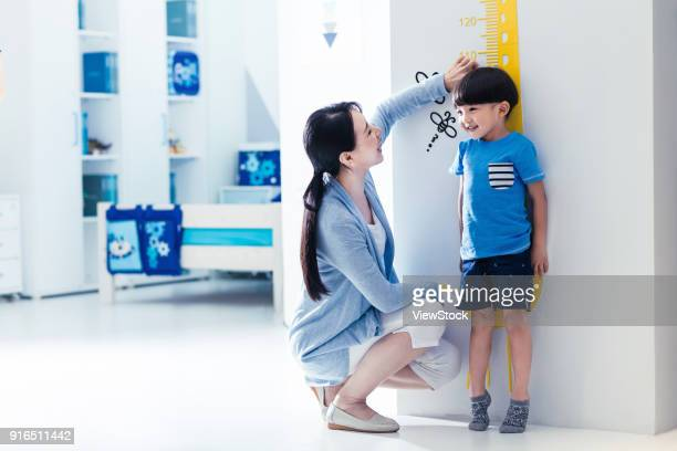 Mother is for the little boy height measurement