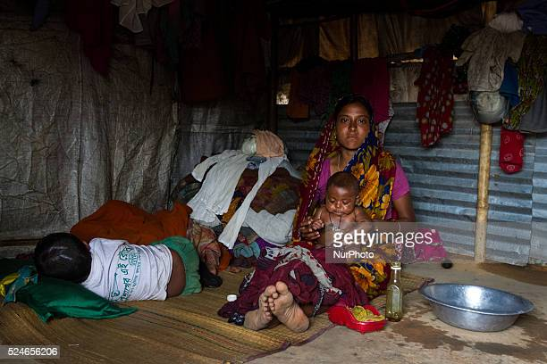 A mother is taking care of her children inside stone workers' village on April 4 2015 in Jaflong Sylhet Bangladesh Stone workers live a miserable...