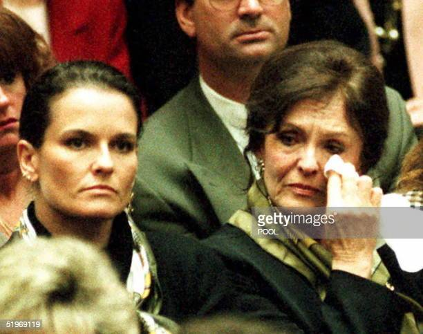 Mother Juditha Brown wipes tears from her eyes as she listens with daughter Denise to prosecutor Christopher Darden's opening statements in the O.J....