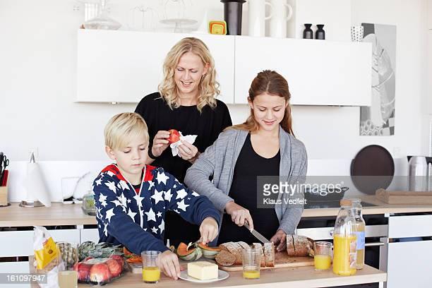 Mother & kids making healthy breakfast