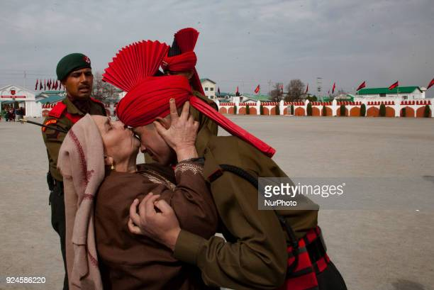 Mother Kisses her son a recruit of Indian army from Kashmir after his passing out parade at a garrison in Rangreth on February 26 2018 in the...
