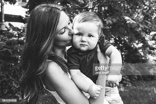 Mother Kissing Child on Cheek