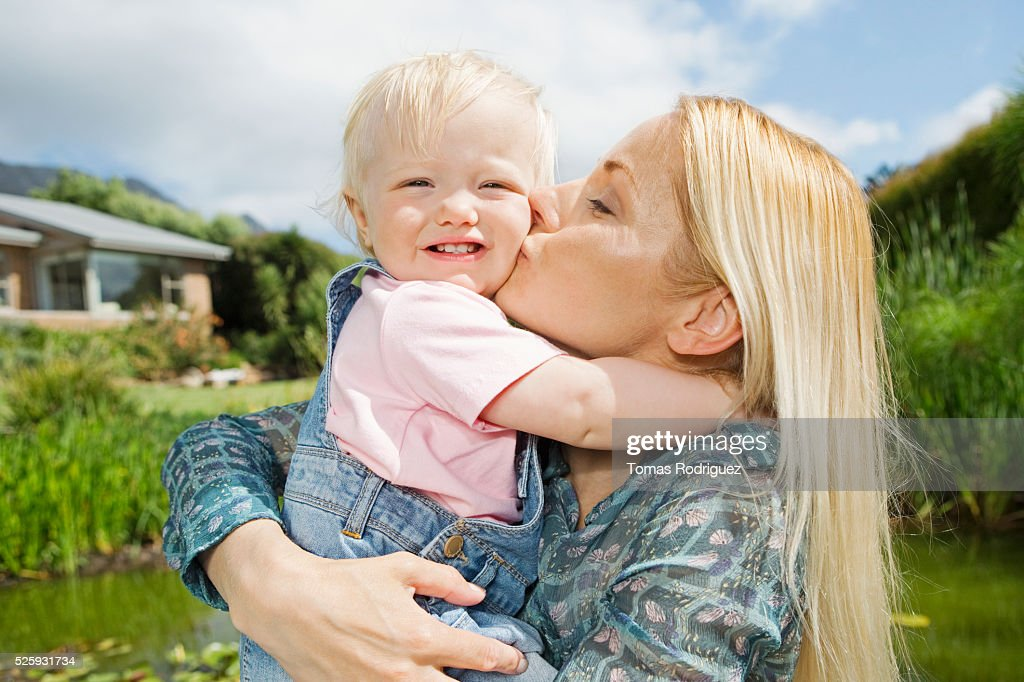 Mother kissing daughter (12-23 months) : Stock Photo