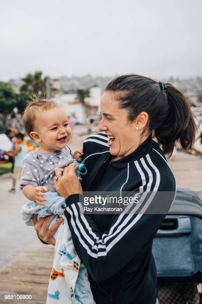 Mother laughing with child