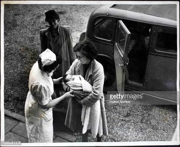 Mother leaving Shardeloes mansion, a maternity home in Amersham, Buckinghamshire with her new baby after the birth, 2nd October 1944. Over 3,000...