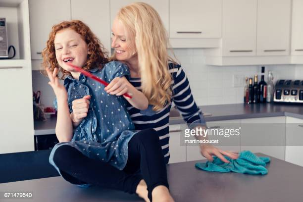 """mother lifting little redhead girl from the counter to clean up. - """"martine doucet"""" or martinedoucet imagens e fotografias de stock"""