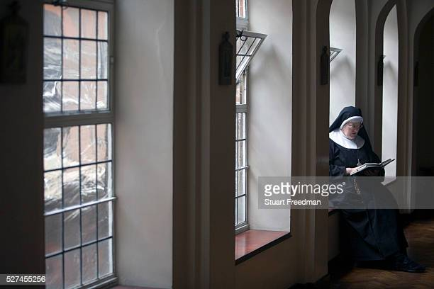 Mother Lioba reading a bible at Tyburn Convent London UK Tyburn near Marble Arch was the site of ' The King's Gallows' from 1196 to 1783 It was...