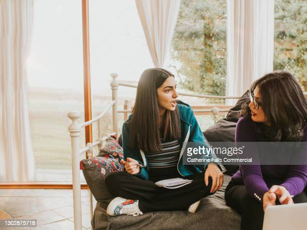 a mother listens to her teenage daughter intently - discussion stock pictures, royalty-free photos & images