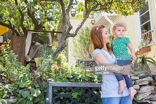 Mother looking at child in arms