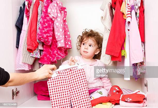 Mother looking through a closet