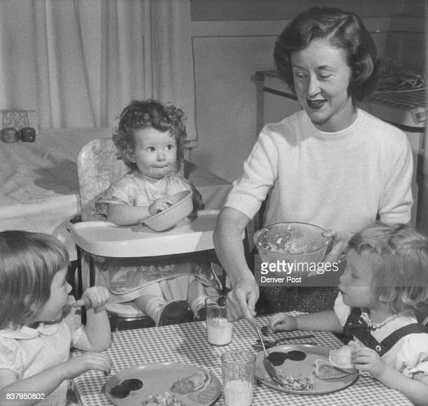 Mother Makes Mealtime Investing Mrs George Leman 3807 W 23rd Ave pleases her daughters Megan 3 1/2 Emilie 18 months and Mary 2 1/2 with a menu...