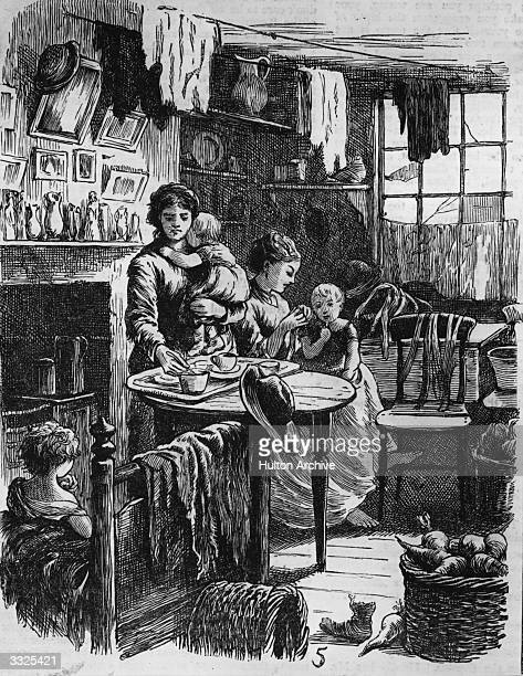 Mother making tea in a small slum dwelling on Golden Lane, London. Original Publication: The Graphic