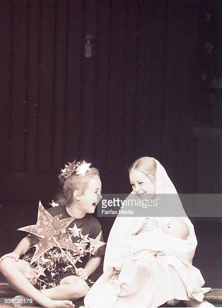 Mother Mary with the Star of Bethlehem - Danielle Benecke of Mosman who plays the star of Bethlehem, pictured with Philippa Johnston of Mosman who is...