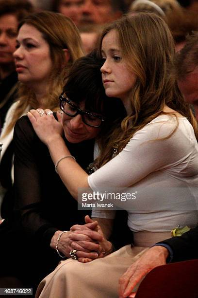 APRIL 4 Mother May Allison and sister Riley Allison comfort each other during a gathering of friends and family to celebrate the life of Carley...