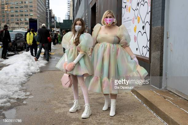 Mother Michelle Blashka and daughter Ella Sophie Blashka wearing matching pastel colored dresses pose outside New York Fashion Week at Spring Studios...