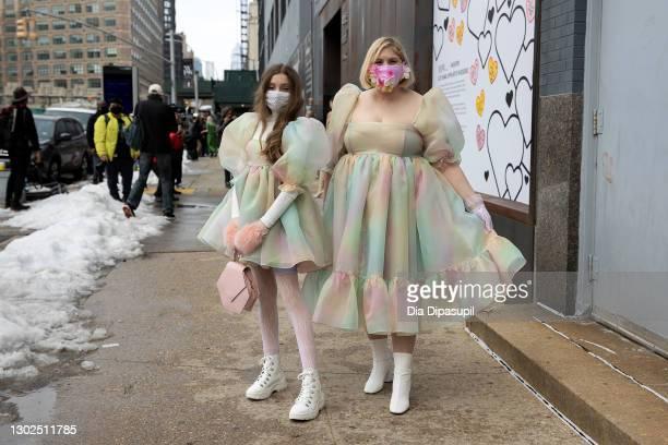 Mother Michelle Blashka and daughter Ella Sophie Blashka wearing matching pastel colored dresses pose outside New York Fashion Week at Spring Studios...