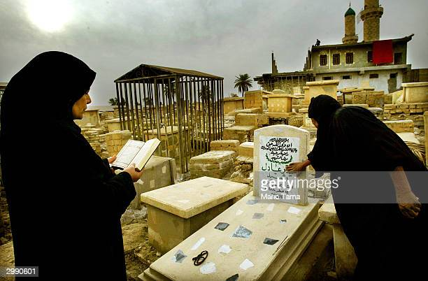 A mother mourns over the grave of her dead son Heider Adil who was killed in 2003 during the war at the Buratha Cemetery January 22 2004 in Baghdad...