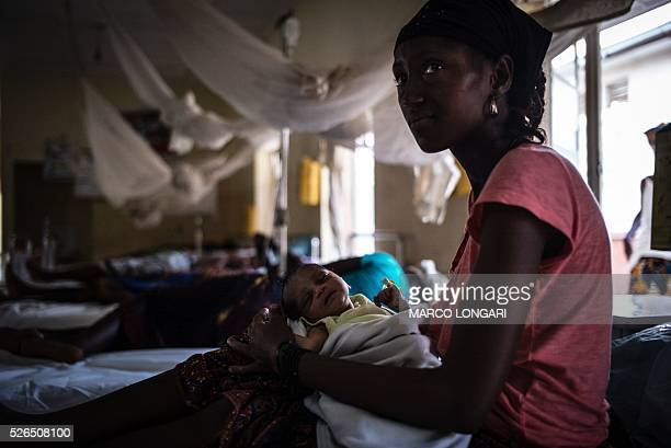 MAHONY A mother nurses her newborn at the maternity ward of the Kailahun Government hospital on April 26 eastern Sierra Leone Hard hit by spread of...