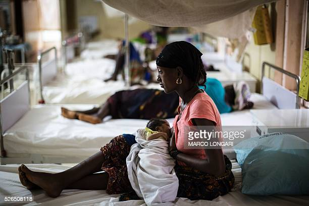 Mother nurses her newborn at the maternity ward of the Kailahun Government hospital on April 26 eastern Sierra Leone. Hard hit by spread of the Ebola...