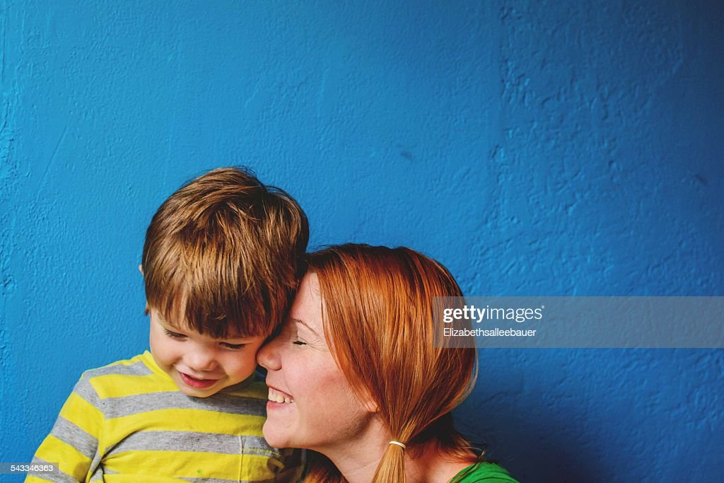 Mother nuzzling son's (2-3) face : Stock Photo