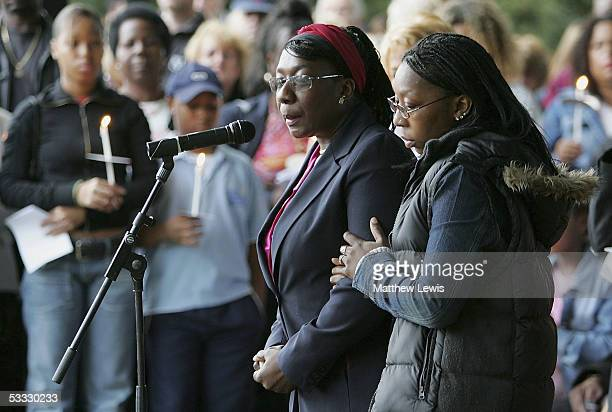 Mother of 18yearold Anthony Walker Gee Walker is consoled as she speaks to the hundreds of people during a candlelit procession from StGabriel's...