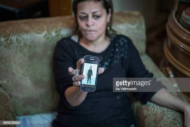 Mother of 19yearold Muhammad Musallam an Israeli Arab executed by Islamic State in Syria sits in her home on March 11 2015 in East Jerusalem Israel...
