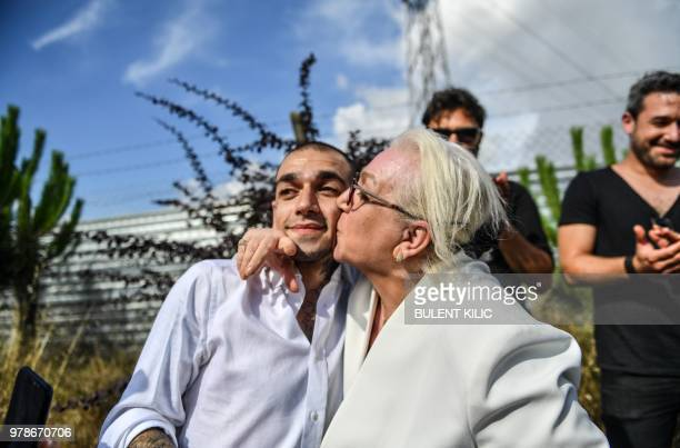 Mother of 28 year old Turkish rapper 'Ezhel' kisses his son whose real name is Omar Sercan Ipekcioglu after he was released on June 19 2018 in front...
