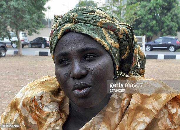 Mother of a kidnapped Chibok schoolgirl Rebecca Samuel speaks on February 25 2015 in Abuja about her 17yearold daughter Sarah who was abducted by...
