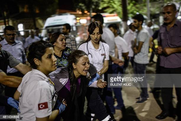 A mother of a victim cries for her son after in city of Gaziantep following the attack in which killed at least 31 in a southern Turkish town on July...