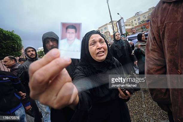 A mother of an Egyptian football fan sentenced to death marches on February 1 2013 in Port said Egypt 21 football fans of Port Said were sentenced to...