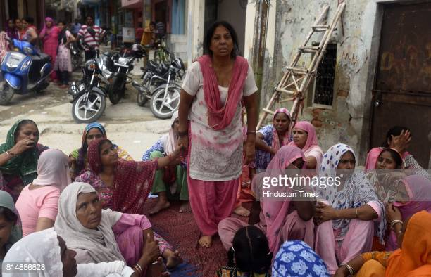 Mother of Billu with other family members crying who was died during the septic tank cleaning at Ghiloni in Chattarpur area on July 15 2017 in New...