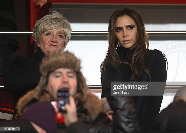 Mother of David Sandra Beckham and Victoria Beckham cheer for David Beckham of PSG who plays for the first time for his new team during the French...