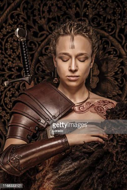 mother of dragons beautiful woman warrior - traditional armor stock pictures, royalty-free photos & images
