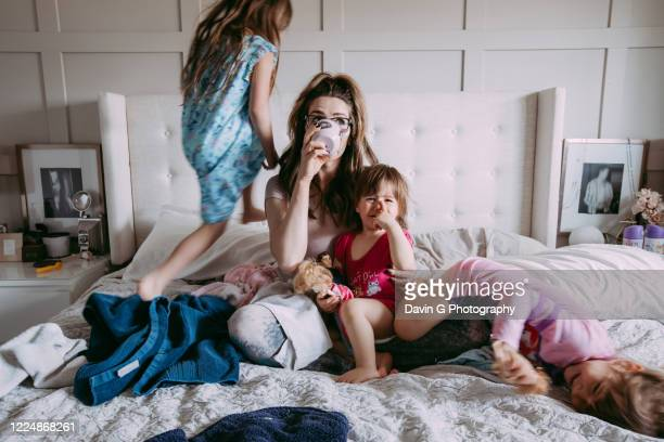 mother of girls - huddle stock pictures, royalty-free photos & images