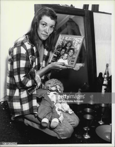 Mother of Jane Jenkins of Augusta TCE Manly in her burnt out unite holding photo of her four children Timothy Matthew Deborah and Nicholas whom she...