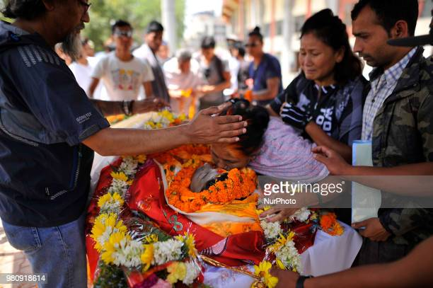 Mother of late Narayan Gopal Maharjan give last tribute on body in Kathmandu Nepal on Thursday June 21 2018 The final rites of Nepali mountain biker...