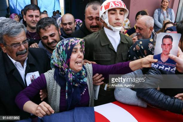 Mother of martyred specialized infantry sergeant Selim Vurdal who was martyred during the 'Operation Olive Branch' mourns around his coffin during a...