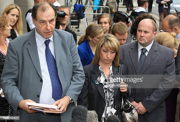 Mother of murdered toddler James Bulger Denise Fergus and husband Stuart Fergus stand as a statement is read out by spokesmen Chris Johnson outside...
