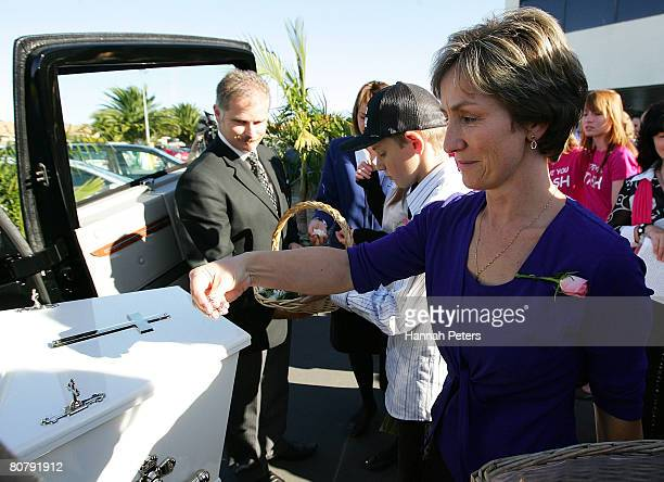 Mother of Natasha Bray Nikki Bray scatters flower petals over her daughters' coffin after her funeral at Elim Christian College on April 21 2008 in...
