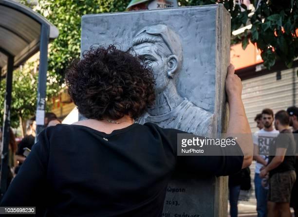 Mother of Pavlos Fyssas hugs the statue of her son in Keratsini September 2018 September 2018 marks 5 years since antifascist rapper and shipyard...