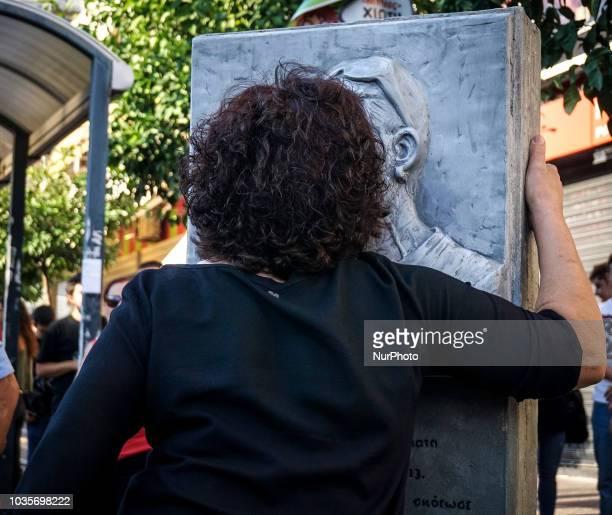 Mother of Pavlos Fyssas kisses the statue of her son in Keratsini September 2018