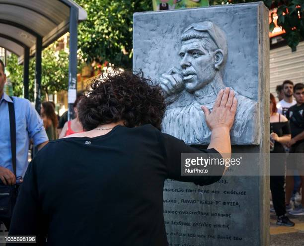 Mother of Pavlos Fyssas touches the statue of her son in Keratsini September 2018 September 2018 marks 5 years since antifascist rapper and shipyard...